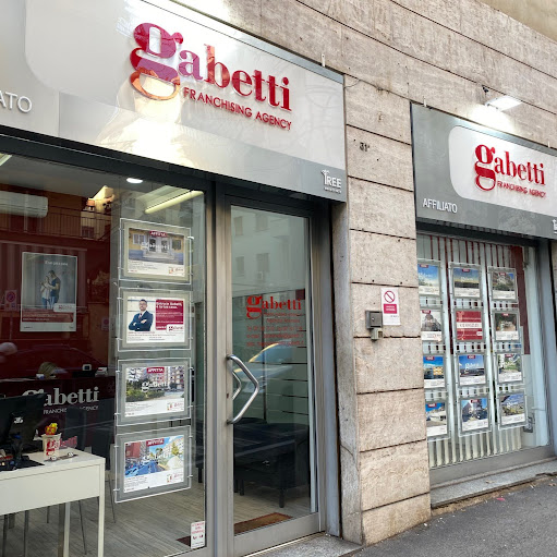 Who is GABETTI NAPOLI ARENELLA?