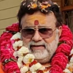 Who is Yogiraj Maharaj Guruji?
