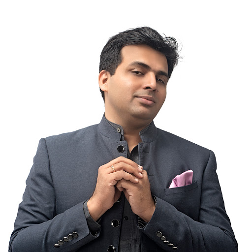 Who is Amit Tandon?
